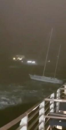 A yach drifts away at sea during storm in Hamilton