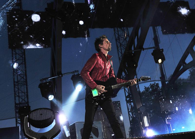 Matt Bellamy performs with Muse during the band's live performance at the Horse Guards Parade following the World Premiere of 'World War Z' in London on Sunday June 2nd, 2013. (Photo by Jon Furniss/Invision/AP Images)