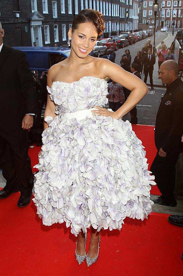 """After much speculation, a rep for Alicia Keys confirmed Thursday that she's engaged to her producer beau Swizz Beatz, and the couple are expecting a baby. The 29-year-old singer hid her baby bump under a voluminous Dolce & Gabbana gown at the Keep A Child Alive Black Ball in London Thursday night. Dave Hogan/Mission Pictures/<a href=""""http://www.gettyimages.com/"""" target=""""new"""">GettyImages.com</a> - May 27, 2010"""