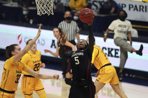 Stanford's Francesca Belibi (5) shoots against California's Sela Heide (32) during the first half of an NCAA college basketball game, Sunday, Dec. 13, 2020, in Berkeley, Calif. (AP Photo/Jed Jacobsohn)