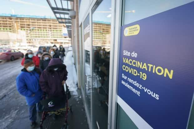 People wait outside the Laval vaccination centre on Thursday, the first day vaccines were made available to Quebecers in the general population born in 1936 or earlier.  (Ivanoh Demers/Radio-Canada - image credit)
