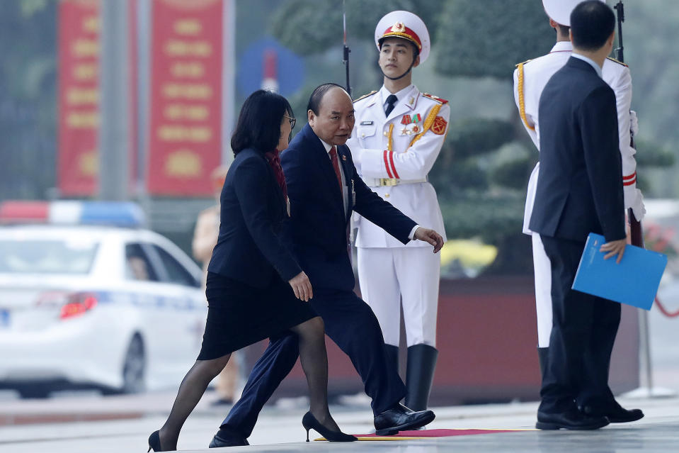 Vietnam's Prime Minister Nguyen Xuan Phuc, second left, arrives for the opening ceremony of the 13th National Congress of Vietnam's Communist Party (VCP), in Hanoi, Vietnam Tuesday, Jan. 26, 2021. (AP Photo/Minh Hoang)