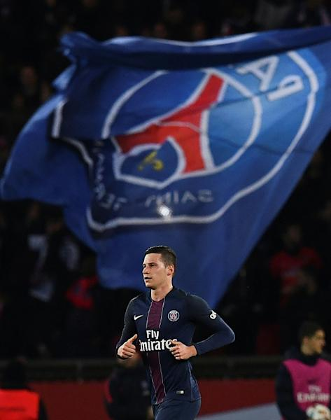 Paris Saint-Germain's midfielder Julian Draxler celebrates scoring against Olympique Lyonnais on March 19, 2017