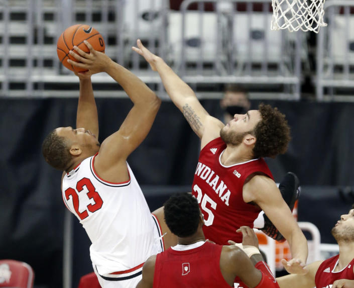 Ohio State forward Zed Key, left, goes up for a shot against Indiana forward Race Thompson during the first half of an NCAA college basketball game in Columbus, Ohio, Saturday, Feb. 13, 2021. (AP Photo/Paul Vernon)
