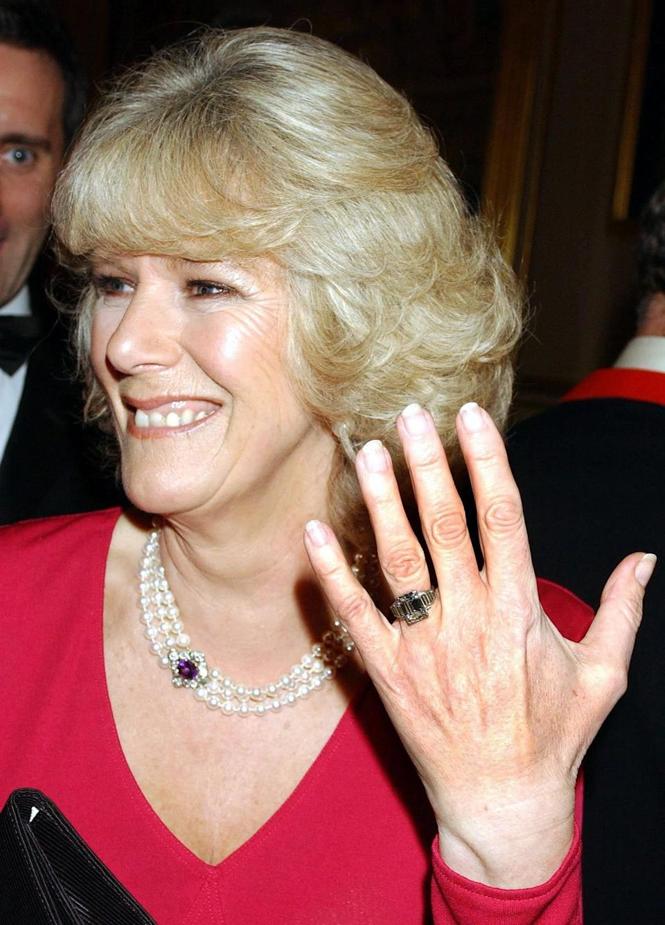 Camilla Parker Bowles showing off her vintage diamond engagement ring in February 2005 - John Stillwell/PA/Pool