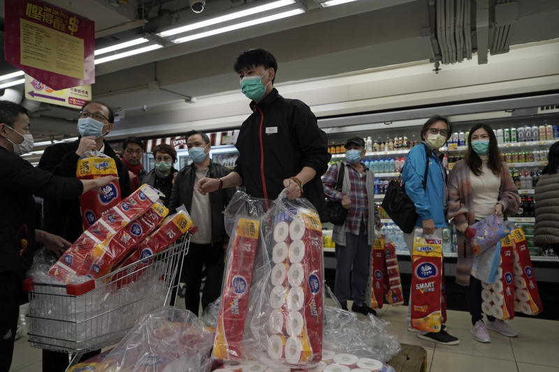 Customers queue to buy supplies of toilet paper in a supermarket in Hong Kong, Feb. 14, 2020. (AP Photo/Kin Cheung)