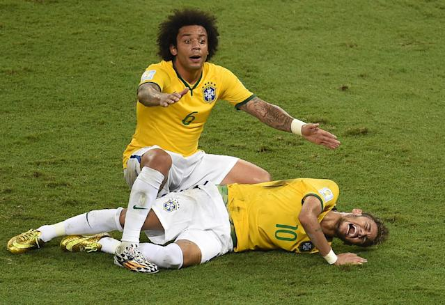 Defender Marcelo shouts for help after Brazil's forward Neymar was injured during the quarter-final football match between Brazil and Colombia at the Castelao Stadium in Fortaleza during the 2014 FIFA World Cup on July 4, 2014 (AFP Photo/Odd Andersen)