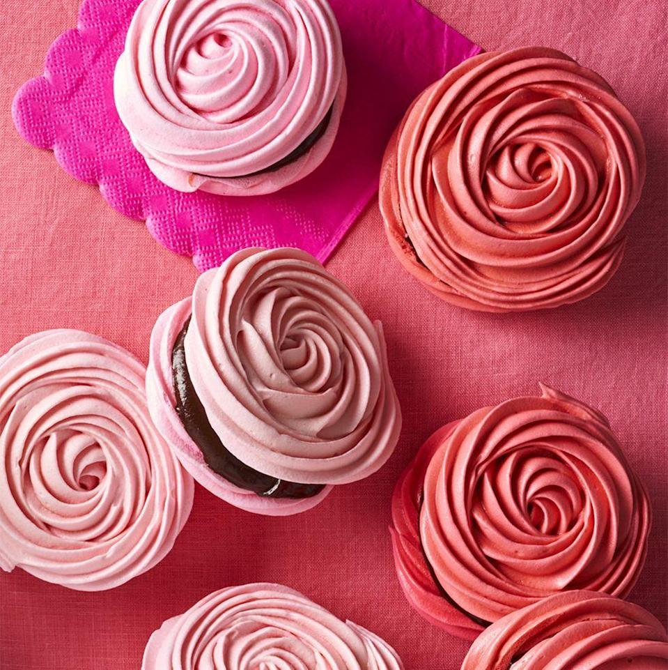 """<p>Flex your baking skills by whipping up a batch of these impressive-looking crispy meringue shells filled with chocolate ganache.</p><p><a href=""""https://www.womansday.com/food-recipes/a35140646/chocolate-stuffed-meringues-recipe/"""" rel=""""nofollow noopener"""" target=""""_blank"""" data-ylk=""""slk:Get the recipe for Chocolate-Stuffed Meringues."""" class=""""link rapid-noclick-resp""""><em>Get the recipe for Chocolate-Stuffed Meringues.</em></a></p>"""
