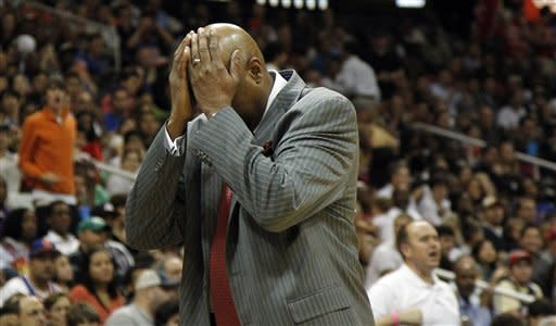 New York Knicks head coach Mike Woodson reacts after a foul in the second half of an NBA basketball game against the Atlanta Hawks, Friday, March 30, 2012, in Atlanta. Atlanta won 100-90. (AP Photo/John Bazemore)
