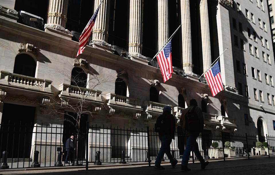 New York Stock Exchange (NYSE) at Wall Street on January 12, 2021 in New York City. - US stocks on January 11, 2021 retreated from records set last week as political uncertainty, including efforts to remove President Donald Trump from power, has finally shaken investors. (Photo by Angela Weiss / AFP) (Photo by ANGELA WEISS/AFP via Getty Images)