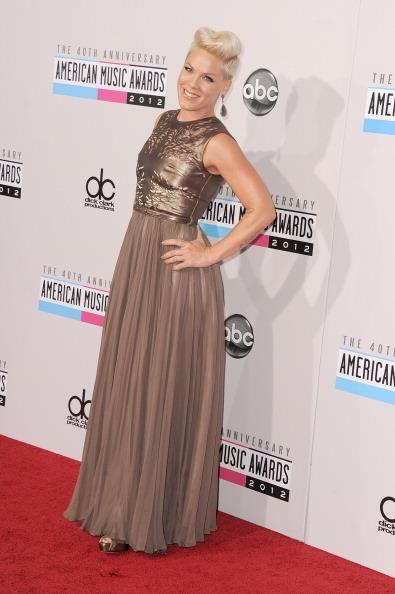 Pink arrives on the 2012 American Music Awards red carpet.