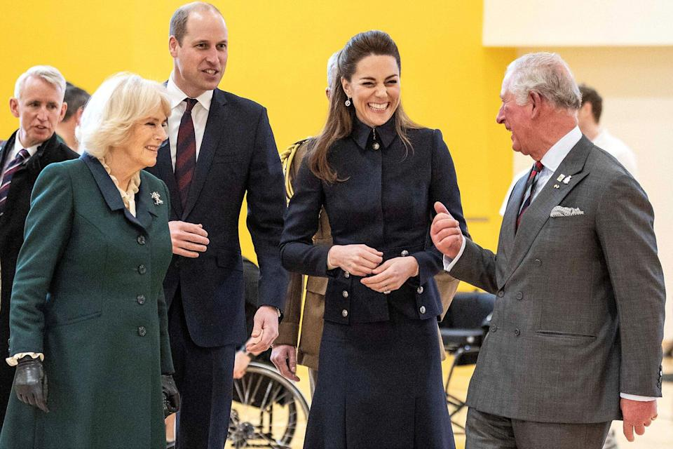 Britain's Prince William, Duke of Cambridge (3L) and his wife Britain's Catherine, Duchess of Cambridge talk with his father Britain's Prince Charles, Prince of Wales (R) and his wife Britain's Camilla, Duchess of Cornwall
