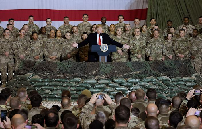 President Donald Trump speaks to the troops in 2019 during a surprise Thanksgiving day visit at Bagram Air Field in Afghanistan.