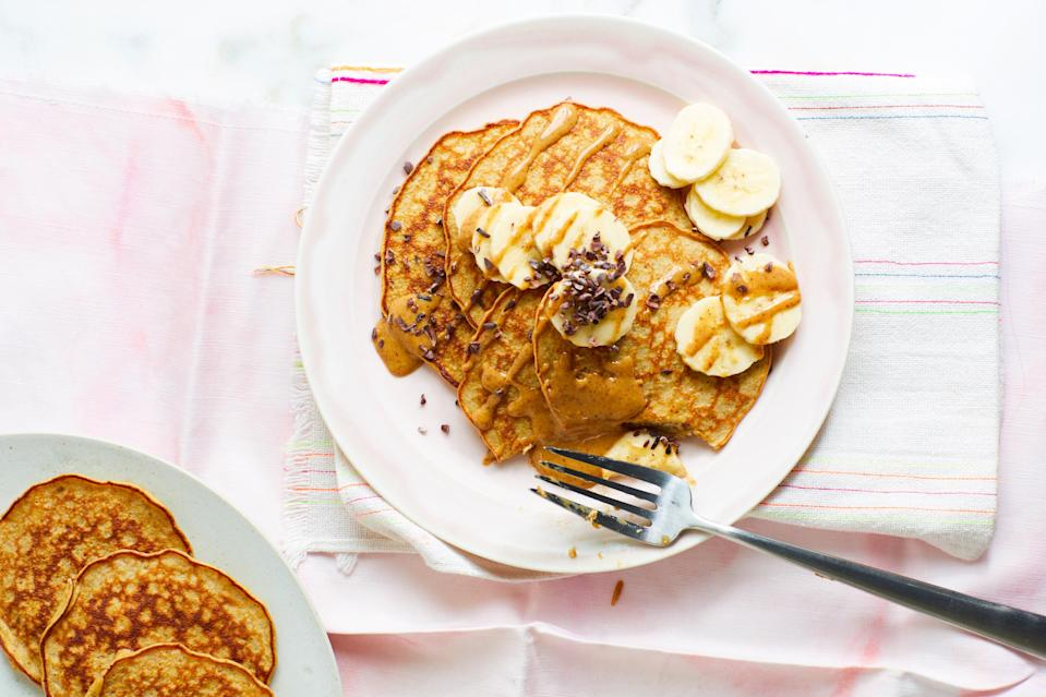 """If flapjacks are more your thing, bananas also add richness to these pancakes. Top with <em>more</em> sliced bananas and cocoa nibs. <a href=""""https://www.epicurious.com/recipes/food/views/almond-butter-and-banana-pancakes?mbid=synd_yahoo_rss"""" rel=""""nofollow noopener"""" target=""""_blank"""" data-ylk=""""slk:See recipe."""" class=""""link rapid-noclick-resp"""">See recipe.</a>"""