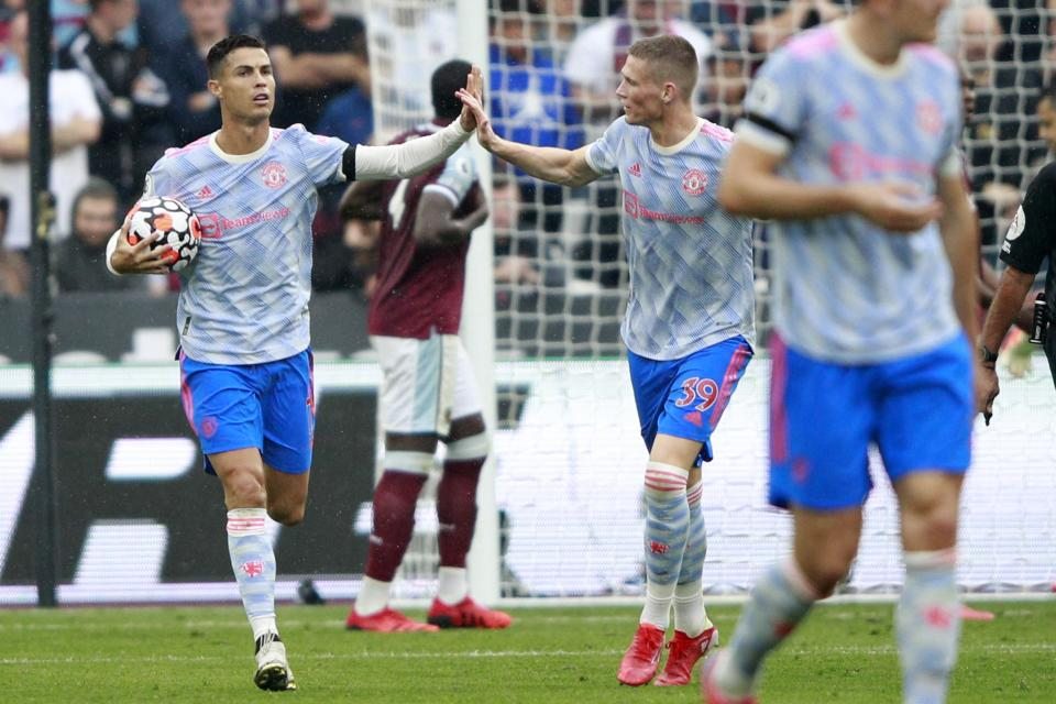 Manchester United's Cristiano Ronaldo, left, celebrates after scoring his side's first goal during the English Premier League soccer match between West Ham United and Manchester United at the London Stadium in London, England, Sunday, Sept. 19, 2021. (AP Photo/Ian Walton)