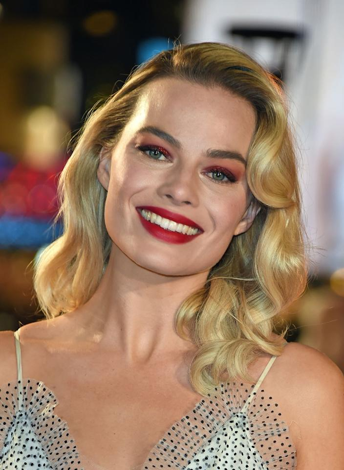 "<p>A sweeping side part, <a rel=""nofollow"" href=""https://www.womansday.com/style/beauty/g3134/short-curly-hairstyles/"">pin curls</a>, and hairspray will give you a Margot Robbie-inspired long bob.</p><p><strong>What you'll need</strong>: Pin curl prongs ($9, <a rel=""nofollow"" href=""https://www.amazon.com/Pangda-Curl-Setting-Section-Clips/dp/B075WPJGM3/"">amazon.com</a>)</p>"