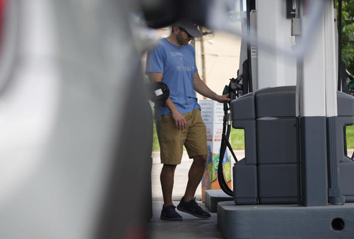 A motorist prepares to fill up the gasoline tank on his vehicle at a Shell station Thursday, July 22, 2021, in southeast Denver. Colorado drivers are facing some of the highest prices per gallon at the pump in more than a decade. (AP Photo/David Zalubowski)