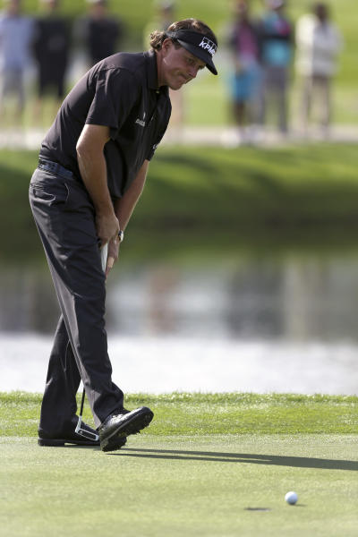 Phil Mickelson reacts to a missed putt on the 17th green during the second round of the Arnold Palmer Invitational golf tournament, Friday, March 22, 2013, in Orlando, Fla. (AP Photo/John Raoux)