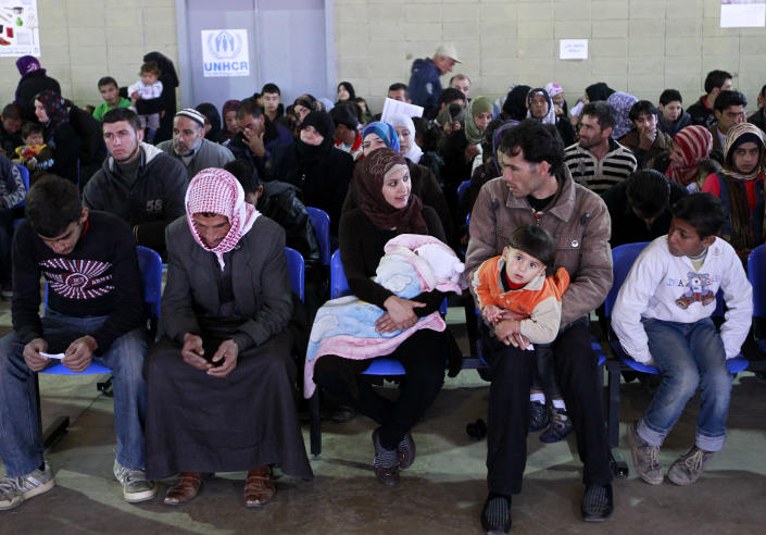 "Syrian families wait their turn to register at the UNHCR center in the northern city of Tripoli, Lebanon, Wednesday, March. 6, 2013. The number of Syrians who have fled their war-ravaged country and are seeking assistance has now topped the one million mark, the United Nations' refugee agency said Wednesday warning that Syria is heading towards a ""full-scale disaster."" (AP Photo/Bilal Hussein)"