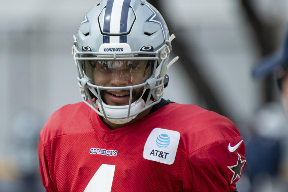 Dallas Cowboys quarterback Dak Prescott in action during practice at the NFL football team's training camp in Oxnard, Calif., Wednesday, July 28, 2021. (AP Photo/Michael Owen Baker)