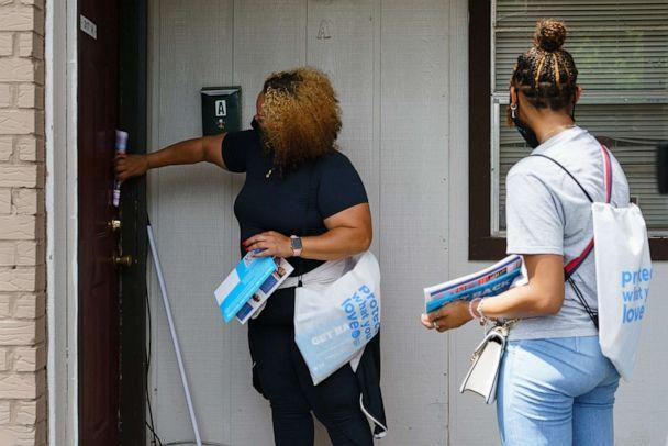 PHOTO: In this June 30, 2021, file photo, volunteers and staffers knock on a door during an outreach effort to inform residents about an upcoming COVID-19 vaccination event in Birmingham, Ala. (Elijah Nouvelage/AFP via Getty Images, FILE)
