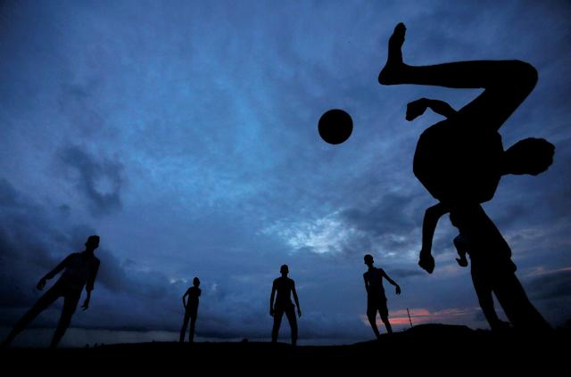 <p>A boy kicks a ball as he plays soccer with his friends at Galle Dutch Fort in Galle, Sri Lanka May 19, 2017. (Photo: Dinuka Liyanawatte/Reuters) </p>