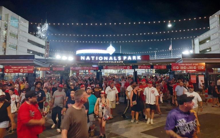 Spectators streamed out of the Nationals Park stadium as a baseball game was interrupted due to a shooting outside the stadium