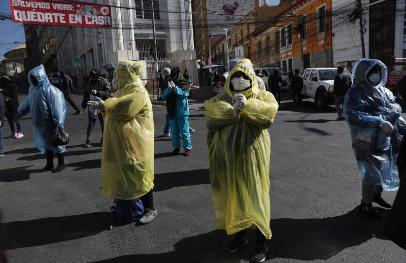 Sex workers wear masks and rains coats during a protest asking the government to ease coronavirus lockdown restrictions in La Paz, Bolivia, Wednesday, June 17, 2020. (AP Photo/Juan Karita)