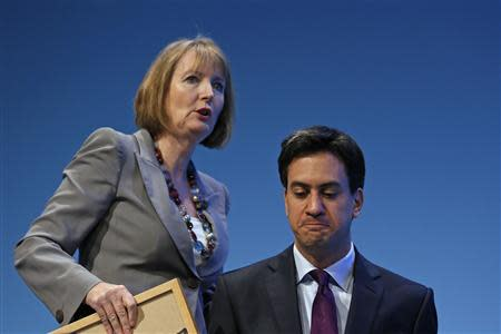 Britain's opposition Labour leader Ed Miliband (R) and deputy leader Harriet Harman attend the annual Labour party conference in Brighton, southern England September 22, 2013. REUTERS/Stefan Wermuth