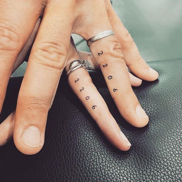 """<p>If you and your partner share a special date (like a wedding anniversary), there's no better way to honor it than with a couples tattoo. I love how this couple went for <a href=""""https://www.cosmopolitan.com/style-beauty/fashion/g3874/best-celebrity-tiny-tattoos/"""" rel=""""nofollow noopener"""" target=""""_blank"""" data-ylk=""""slk:tiny tats"""" class=""""link rapid-noclick-resp"""">tiny tats</a> on their ring fingers.</p><p><a href=""""https://www.instagram.com/p/Btb25m5lgIk/?utm_source=ig_embed&utm_campaign=loading"""" rel=""""nofollow noopener"""" target=""""_blank"""" data-ylk=""""slk:See the original post on Instagram"""" class=""""link rapid-noclick-resp"""">See the original post on Instagram</a></p>"""