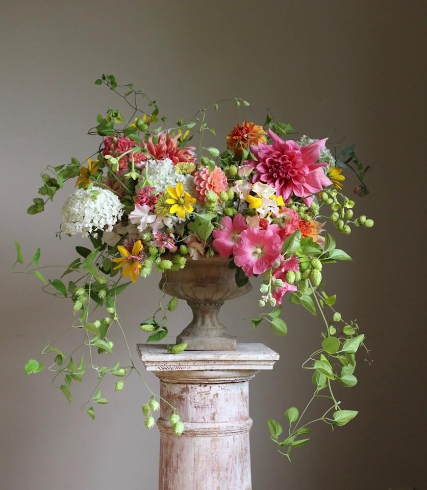 """<p>This happy arrangement, created by <a href=""""https://www.instagram.com/cultivatedbychristin/?hl=en"""" target=""""_blank"""">Cultivated</a>'s Christin Geall, combines watermelon-pink hollyhocks, snapdragons, Agastache, and dahlias with nicotiana, hops, and clematis vines from Geall's garden. """"If there's a time to make use of your garden and local farm product, it's summer,"""" says <a href=""""https://www.instagram.com/cultivatedbychristin"""" target=""""_blank"""">Geall</a>. """"Remember to strip all the leaves from your flowers to slow transpiration and prevent wilting, and give your homegrown blooms a long drink before arranging.""""  </p>"""