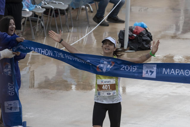Greece's Eleftheria Petroulaki crosses the finish line to win the women's 37th Athens Marathon on Sunday, Nov, 10, 2019. (AP Photo/Yorgos Karahalis)