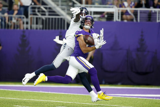Minnesota Vikings wide receiver Adam Thielen, front, tries to make a reception in front of Seattle Seahawks cornerback Tre Flowers, back, during the first half of an NFL preseason football game, Sunday, Aug. 18, 2019, in Minneapolis. Flowers was called for pass interference on the play. (AP Photo/Bruce Kluckhohn)