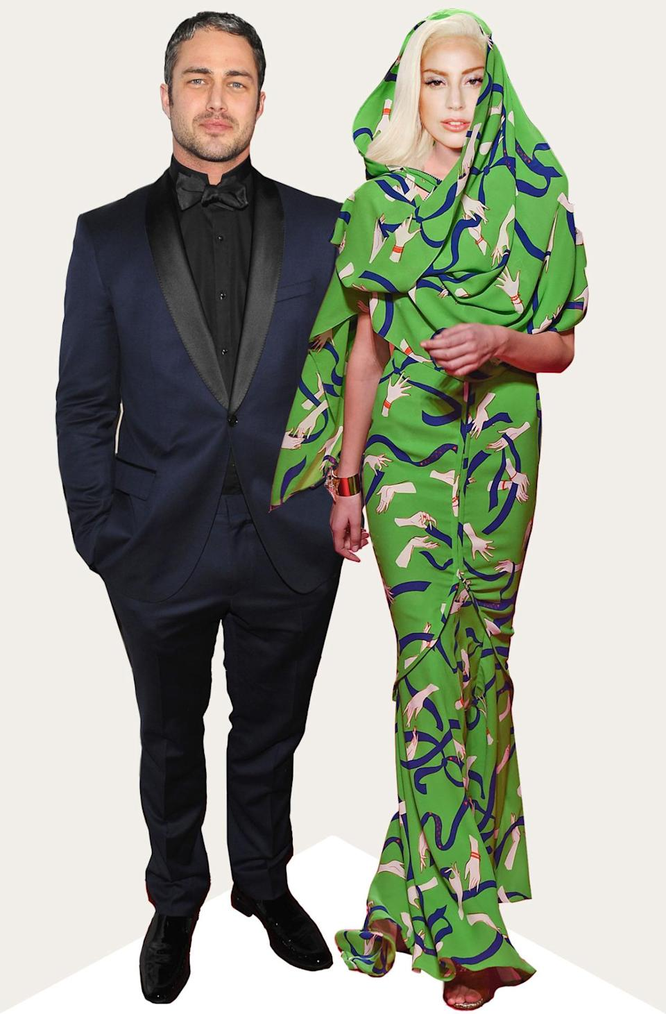 """Lady Gaga has never been one to stick to a straight line so why would she follow the rules on her wedding day? This Schiaparelli green printed gown has a built in veil, making it fit to say """"I do"""" in."""