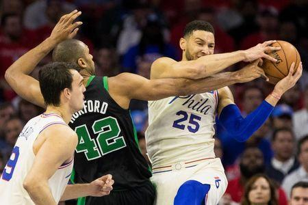 May 7, 2018; Philadelphia, PA, USA; Philadelphia 76ers guard Ben Simmons (25) rebounds the ball past Boston Celtics forward Al Horford (42) during the first quarter in game four of the second round of the 2018 NBA Playoffs at Wells Fargo Center. Mandatory Credit: Bill Streicher-USA TODAY Sports