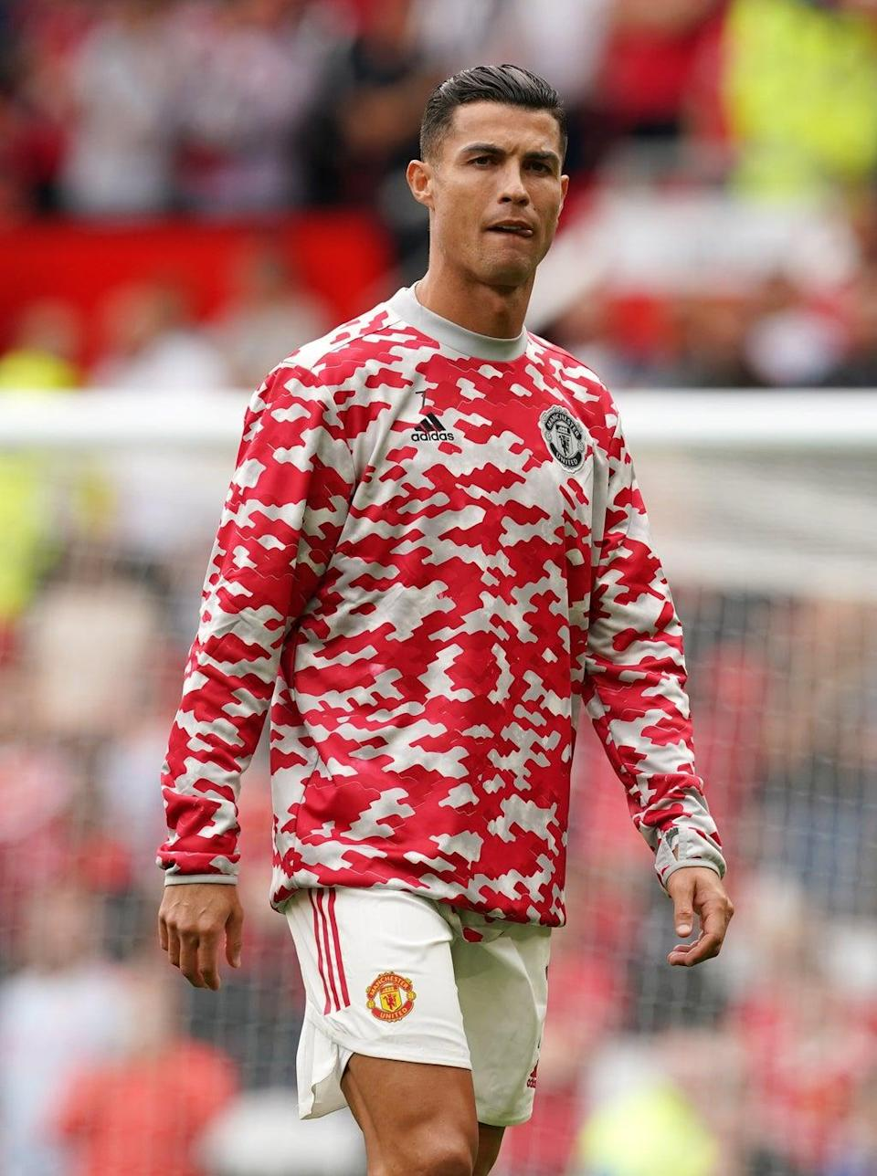 Manchester United's Cristiano Ronaldo warms up prior to kick-off in the Premier League match at Old Trafford (PA) (PA Wire)