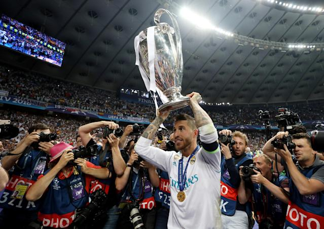 Soccer Football - Champions League Final - Real Madrid v Liverpool - NSC Olympic Stadium, Kiev, Ukraine - May 26, 2018 Real Madrid's Sergio Ramos celebrates winning the Champions League with the trophy REUTERS/Hannah McKay