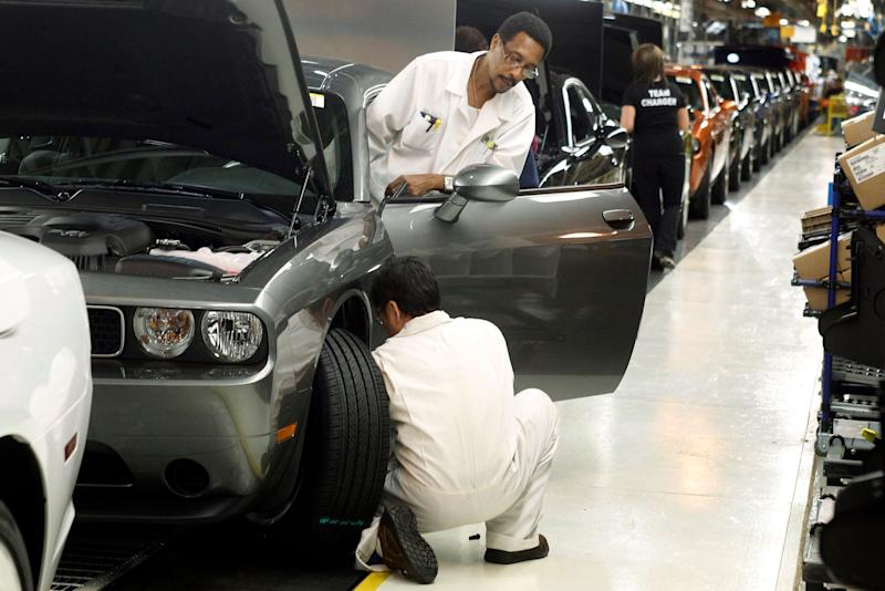 In this Jan. 7, 2011 file photo, employees work on the Chrysler assembly line in Brampton, Ont. A new StatCan study has found the decline of manufacturing jobs has had a significant negative impact on men's employment. (Photo: Mike Cassese / Reuters)
