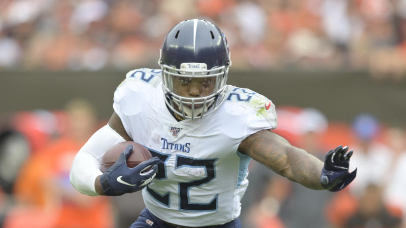 Tennessee Titans running back Derrick Henry (22) still pays attention to the Auburn-Alabama rivalry. (AP Photo/David Richard)