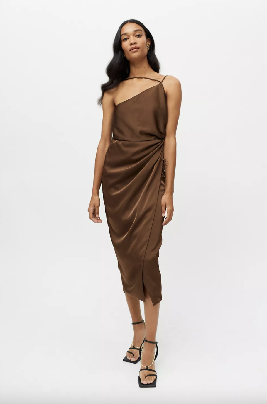 black model posing with brown silky dress and black strappy heels