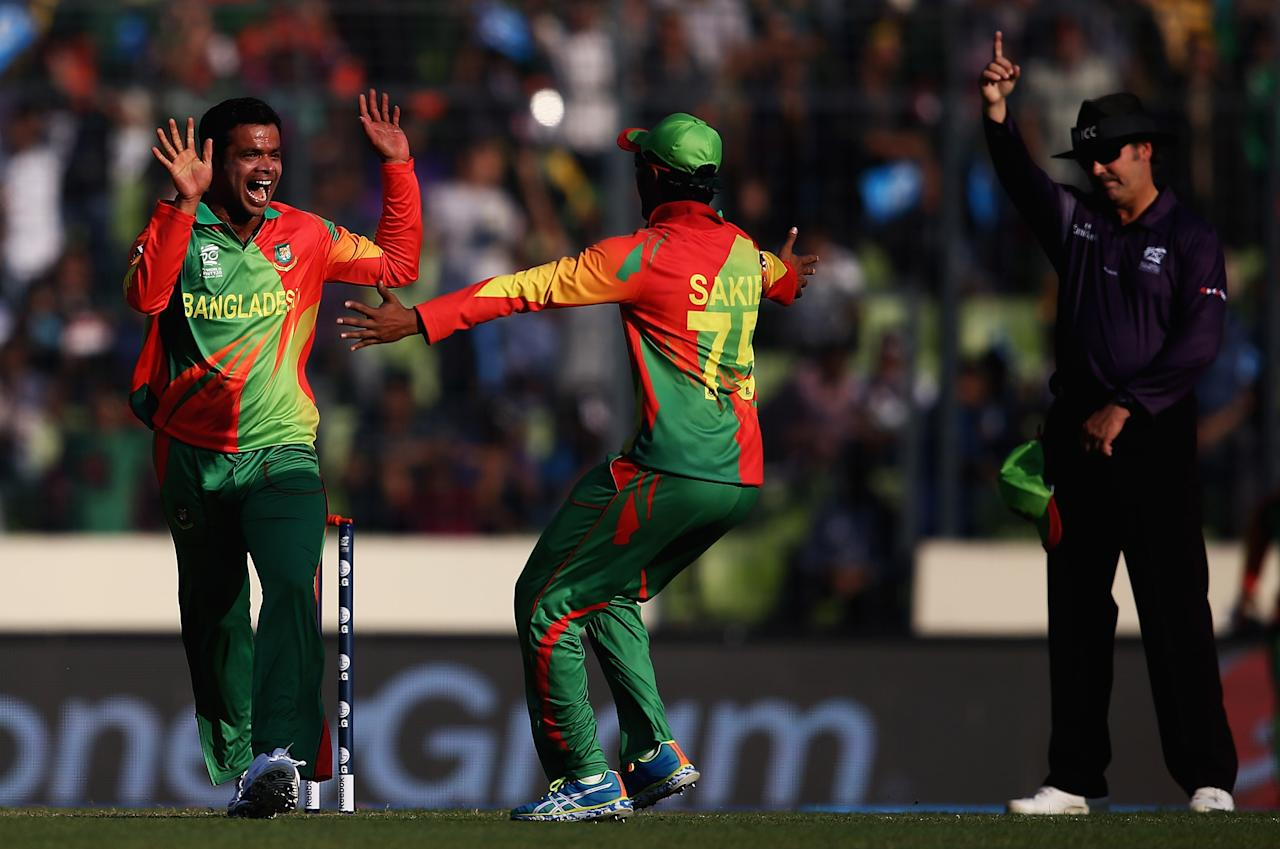 DHAKA, BANGLADESH - MARCH 16:  Abdur Razzak  (L) of Bangladesh celebratews bowling Samiullah Shenwari  of Afghanistan for LBW during the ICC World Twenty20 Bangladesh 2014 match between Bangladesh and Afghanistan at the Sher-e-Bangla Mirpur Stadium on March 16, 2014 in Dhaka, Bangladesh.  (Photo by Matthew Lewis-IDI/IDI via Getty Images)