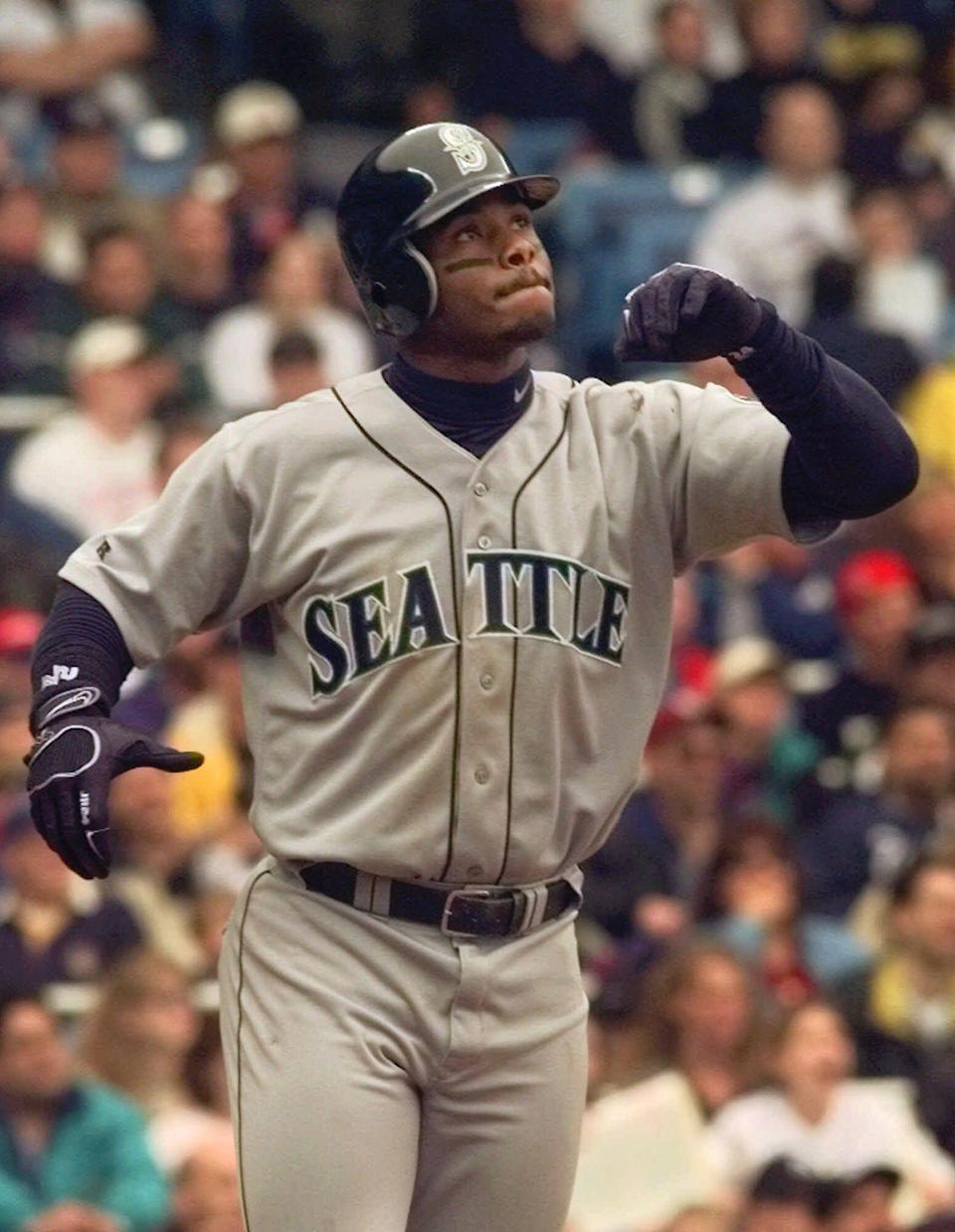 May 8, 1999: Seattle Mariners Ken Griffey, Jr. watches the flight of his two-run sixth inning home run in New York. Griffey was traded from the Mariners to the Cincinnati Reds Thursday, Feb. 10, 2000 after agreeing to a contract with his hometown team.