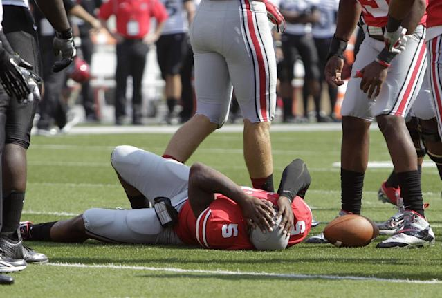 Ohio State quarterback Braxton Miller lies on the ground after being injured during the first quarter of an NCAA college football game against San Diego State on Saturday, Sept. 7, 2013, in Columbus, Ohio. (AP Photo/Jay LaPrete)