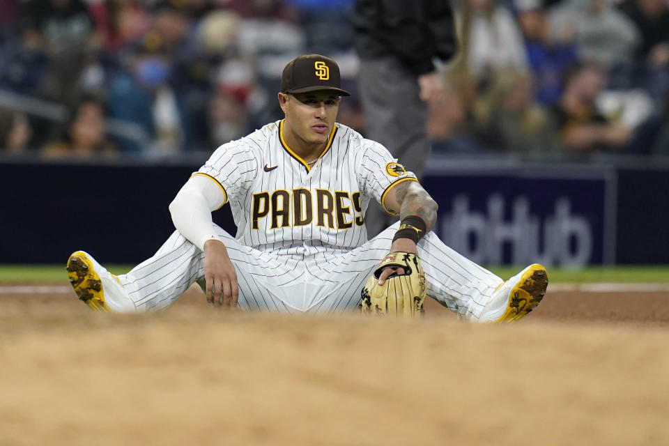 San Diego Padres third baseman Manny Machado looks on after diving and missing a ball hit for a single by Chicago Cubs' Eric Sogard during the seventh inning of a baseball game Monday, June 7, 2021, in San Diego. (AP Photo/Gregory Bull)