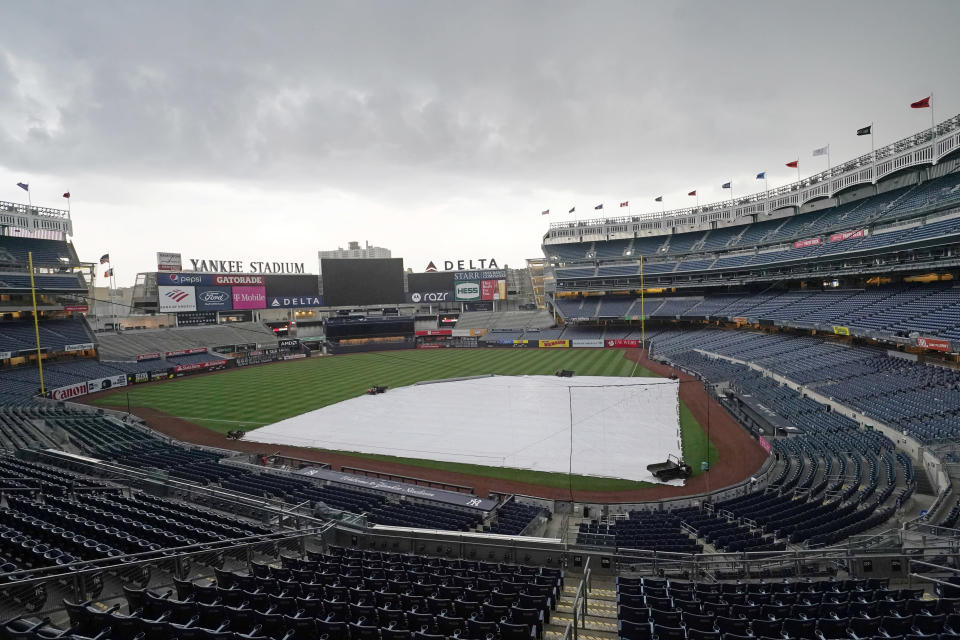 A storm approaches Yankee Stadium after a baseball game between the Toronto Blue Jays and the New York Yankees was postponed due to predicted inclement weather, Wednesday, May 26, 2021, in New York. (AP Photo/Kathy Willens)