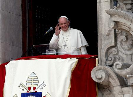 Pope Francis waves to the crowd from the balcony of the Archbishop's Palace of Lima, in Lima