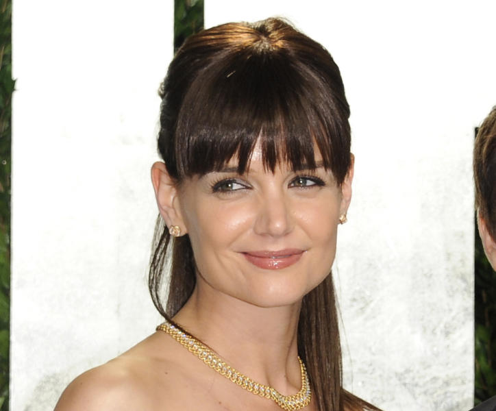 FILE - This Feb. 26, 2012 file photo shows Katie Holmes at the Vanity Fair Oscar party, in West Hollywood, Calif. Holmes, 33, will appear in spring 2013 print ads and displays for Bobbi Brown Cosmetics. Bobbi Brown will also be the lead makeup artist at the Spring/Summer 2013 fashion show for Holmes' clothing line, Holmes & Yang. (AP Photo/Evan Agostini, File)