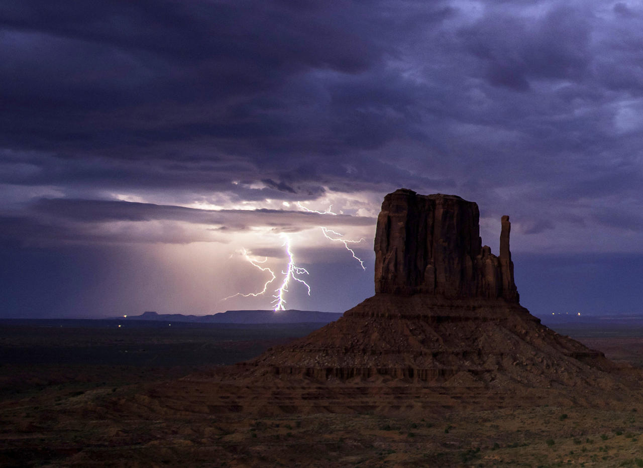 <p>Rain and lightning bolts hammer the desolate terrain of Monument Valley, Arizona. (Photo: Jennifer Khordi/Caters News) </p>