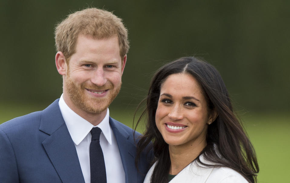 LONDON, ENGLAND - NOVEMBER 27:  Meghan Markle and Prince Harry during an official photocall to announce the engagement of Prince Harry and actress Meghan Markle at The Sunken Gardens at Kensington Palace on November 27, 2017 in London, England.  Prince Harry and Meghan Markle have been a couple officially since November 2016 and are due to marry in Spring 2018.  (Photo by Mark Cuthbert/UK Press via Getty Images)