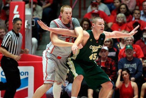 Colorado State's Colton Iverson (45) battles for offensive position in front of New Mexico's Alex Kirk in the second half of their NCAA college basketball game in Albuquerque, N.M., Wednesday, Jan. 23, 2013. New Mexico won 66-61. (AP Photo/Eric Draper)